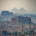 View of Cairo with the Giza pyramids in the distant background, as seen from the Cairo citadel.